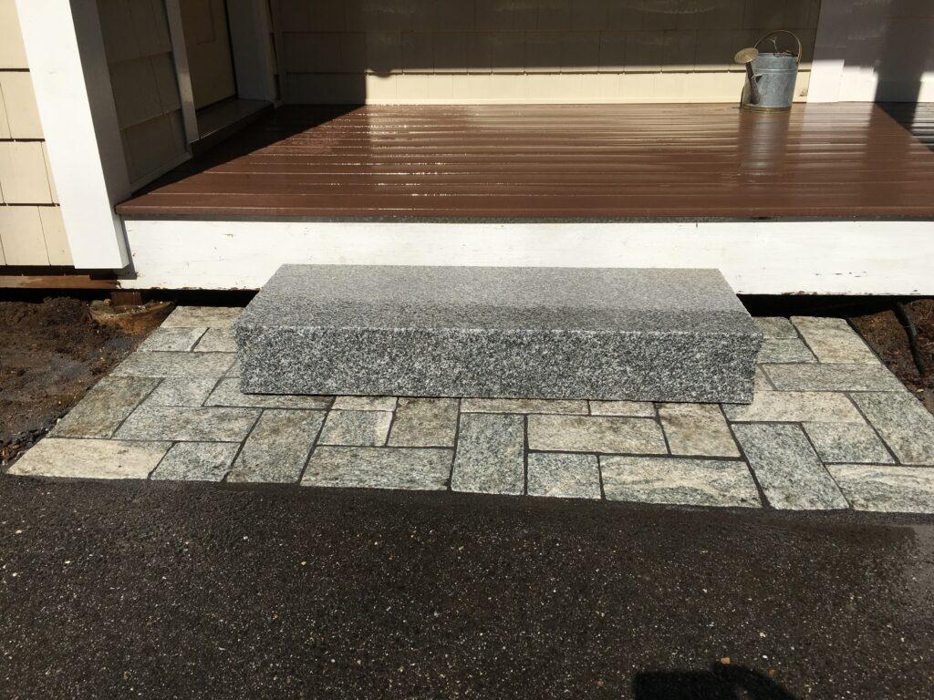 Granite step over granite pavers