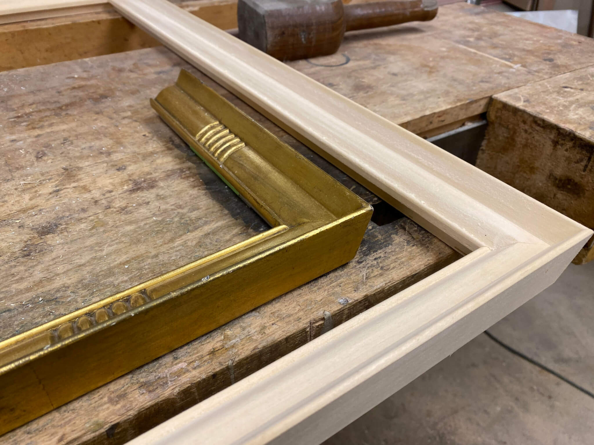 Types of custom picture frames-2 frames on a Chicago work bench in progress