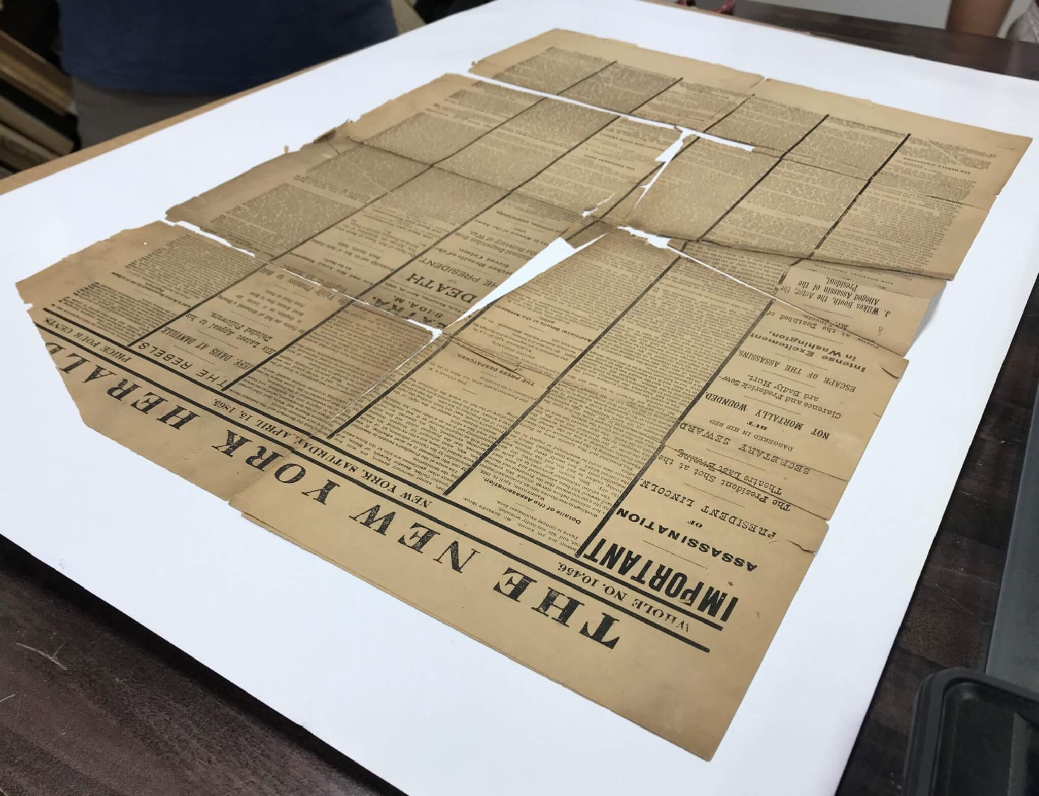 Assassination of Abraham Lincoln Newspaper. Conservation and Restoration of historic newspapers, documents, letters, and books. Artifact Services, Artmill Group, April Hann Lanford