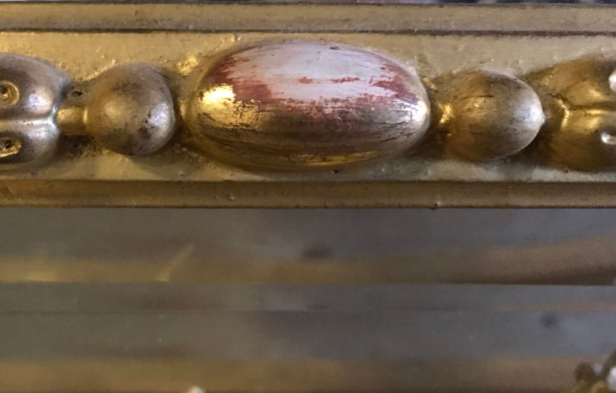Gilded Frame ornamentation that has been overcleaned.  Frame conservation frame restoration frame repair gold leaf gilding repair