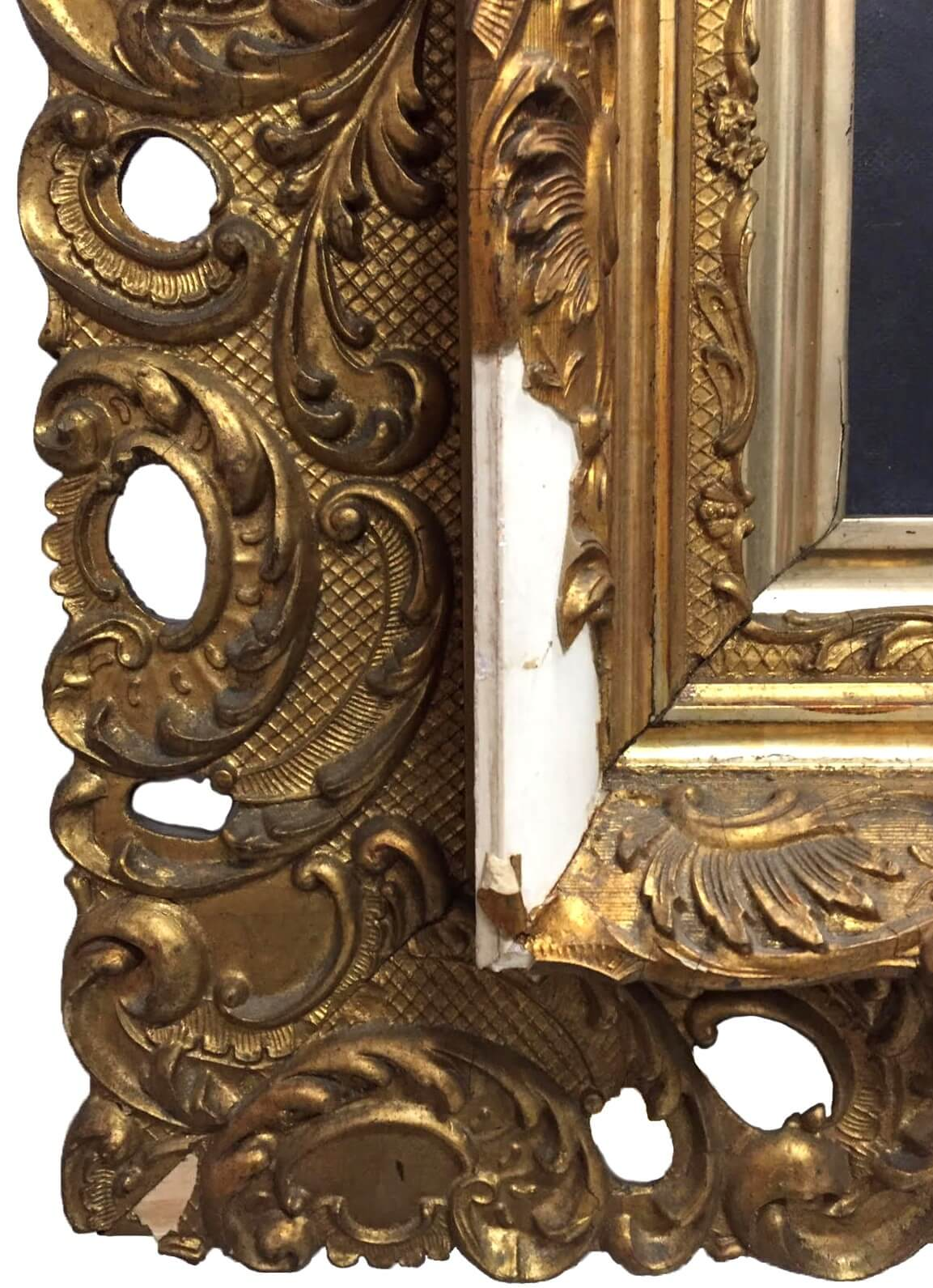 detail of a damaged frame corner. Antique frame restoration. picture frame repair.  The losses can be carved, or cast and then gilded in the repair. Frame restoration chicago