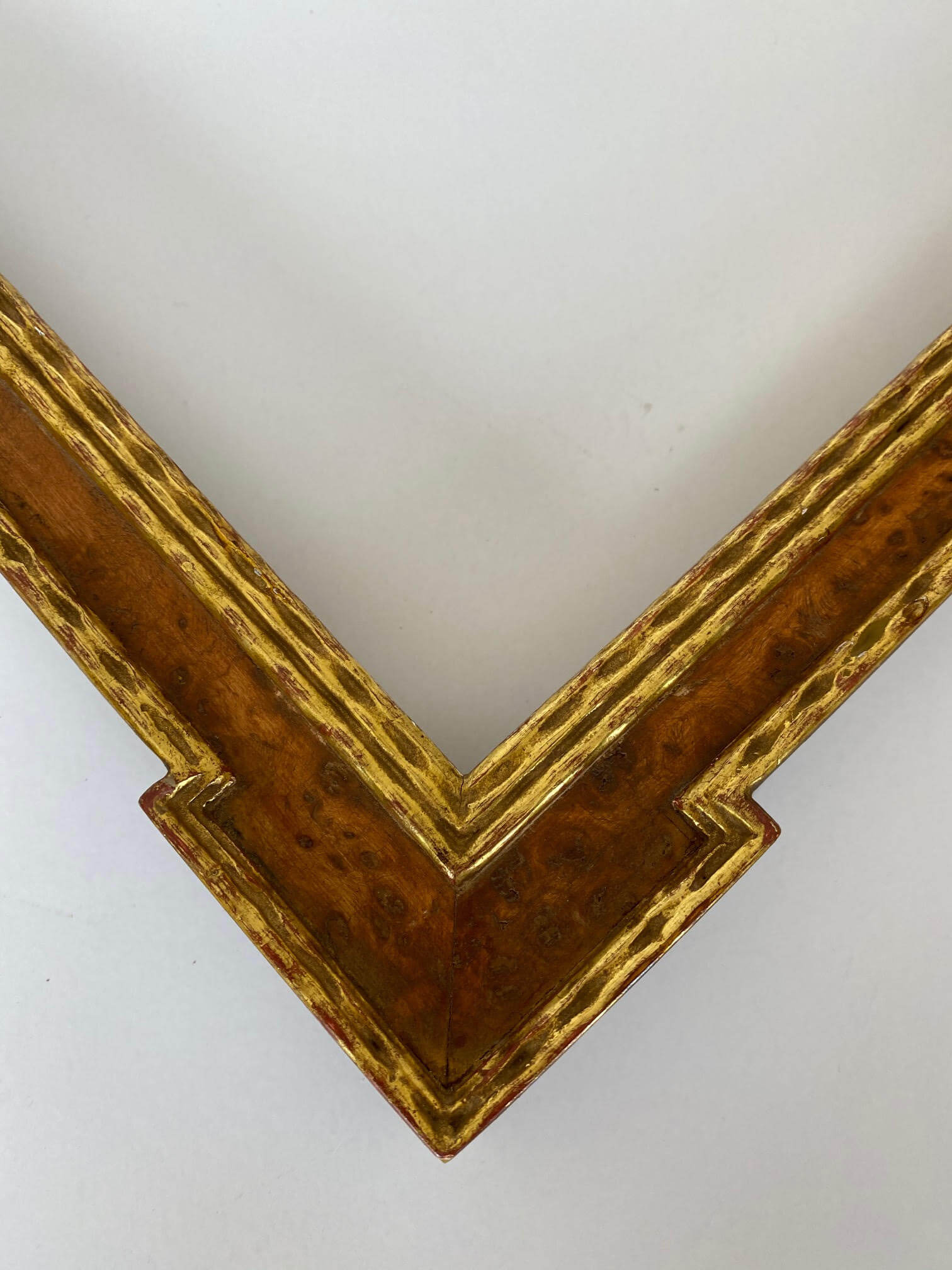 Notched finished corner frame with burled wood veneer and 22 karat gold leaf antique reproduction frame Artifact services artmill group custom picture frames