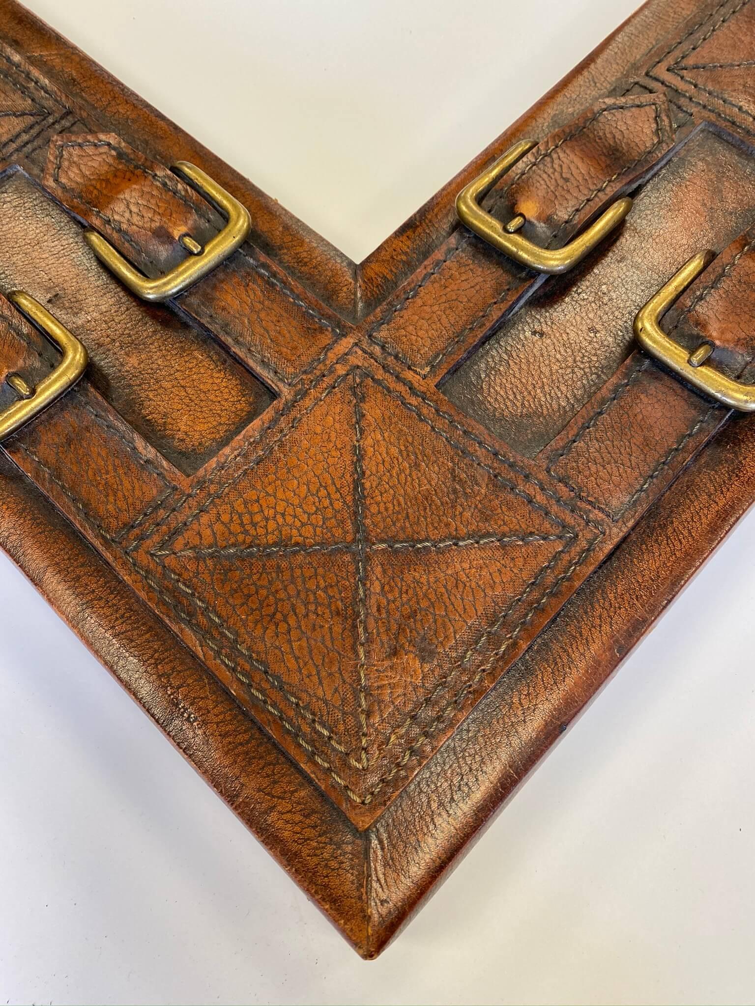 custom framing chicaog, custom framing nashville, brown leather frame with buckles