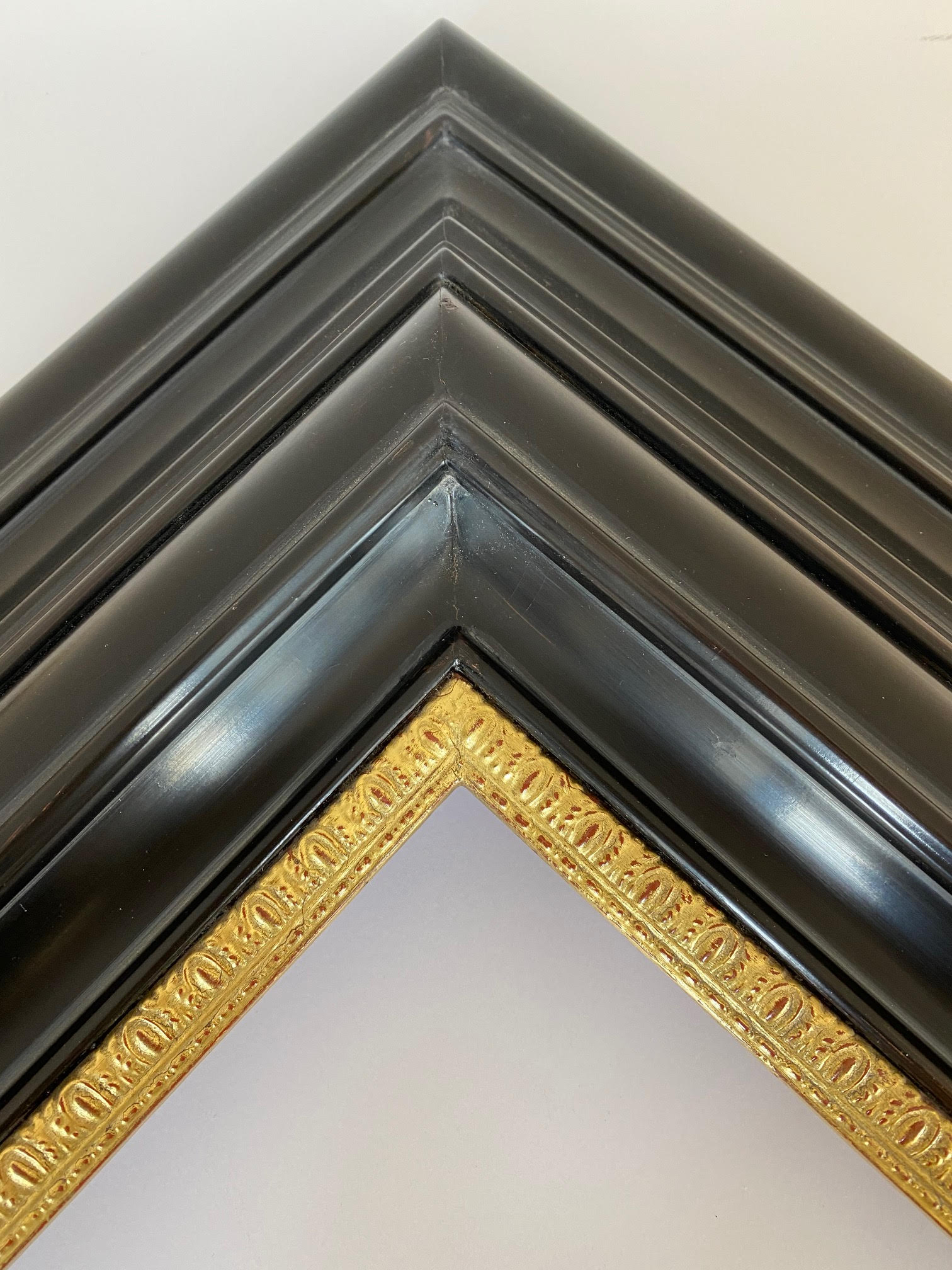 Six inch Black Lacquer frame profile with 22k gilded ornamental lip. Dutch frame options Artifact Services. Artmill Group