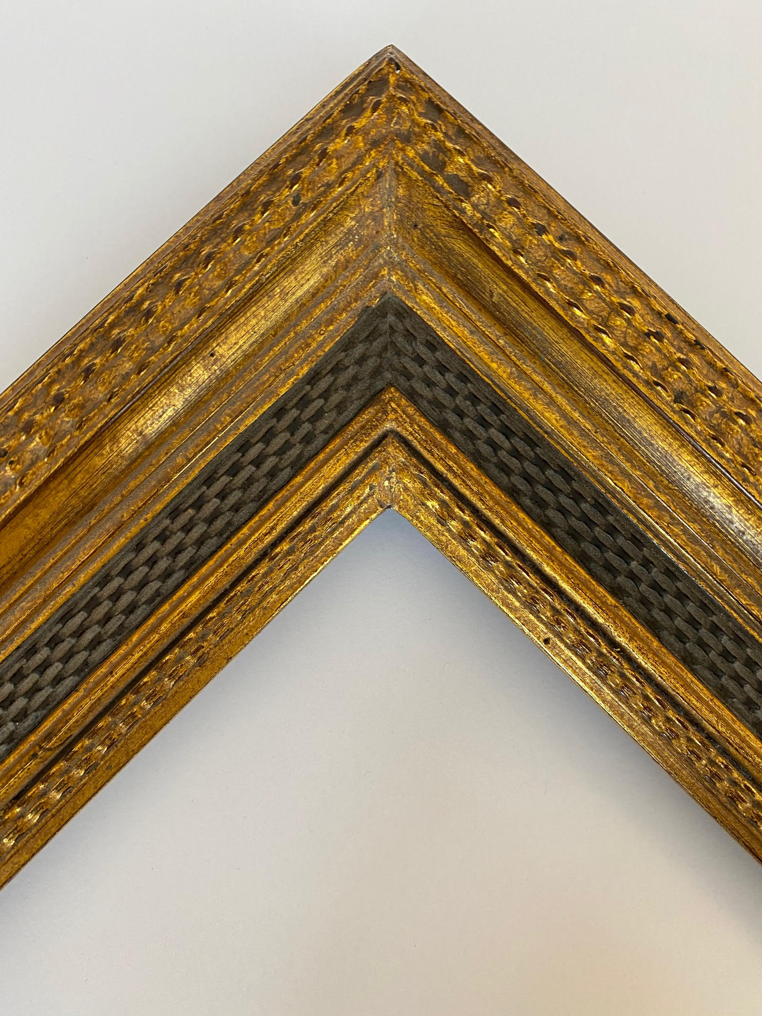Prefinished length molding gold and black Dutch frame with basketweave pattern panel and rippled detail on lip and exterior edge Artifact services artmill Group Chicago