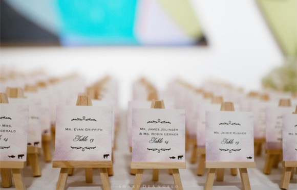 Real Wedding. Easel watercolor escort cards by Hand-Painted Weddings. Photo by Shari Angelo. Wedding planning by Truly You Events.