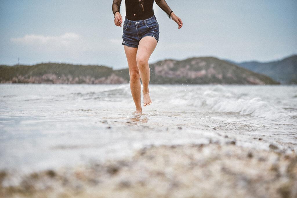 Grounding barefoot on the beach