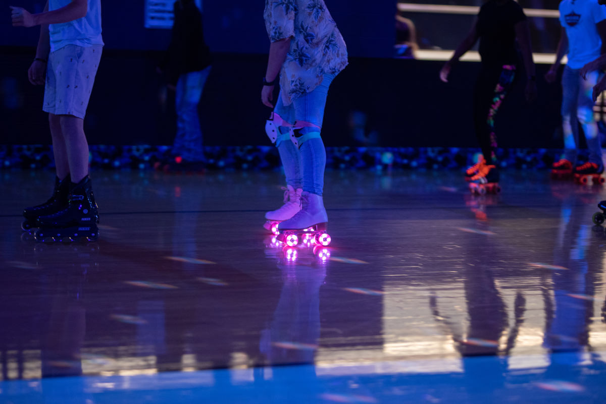 image of woman skating with pink light up wheels
