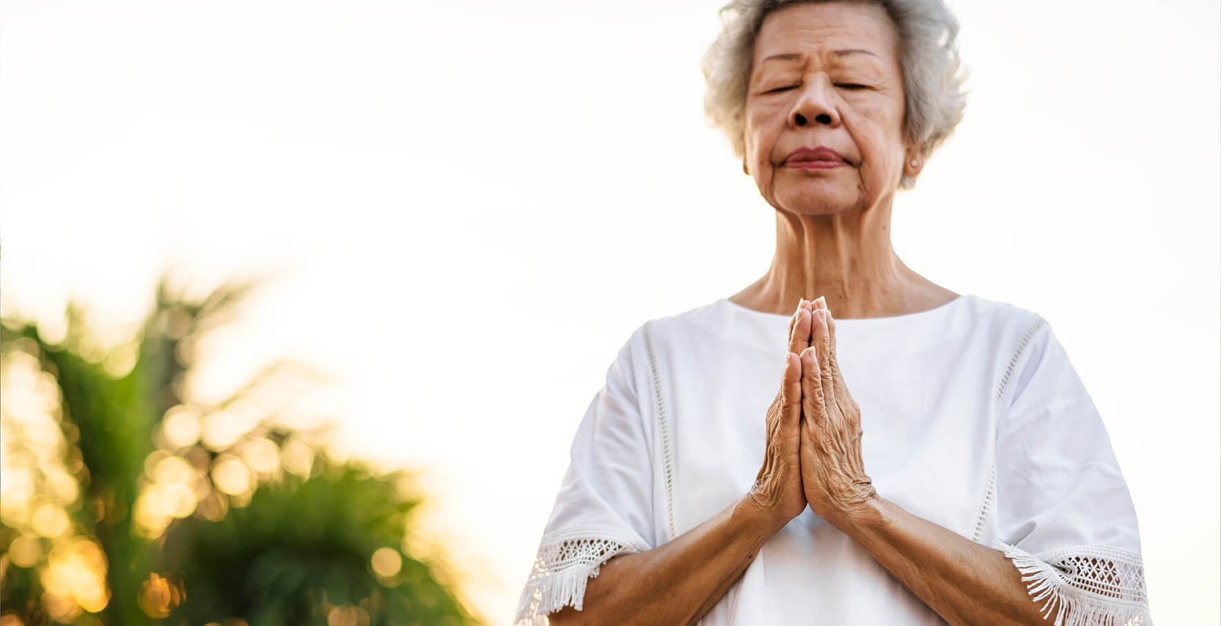 senior woman practicing yoga in the morning HPMKBDQ Cropped small COVID 19/Respiratory Recovery