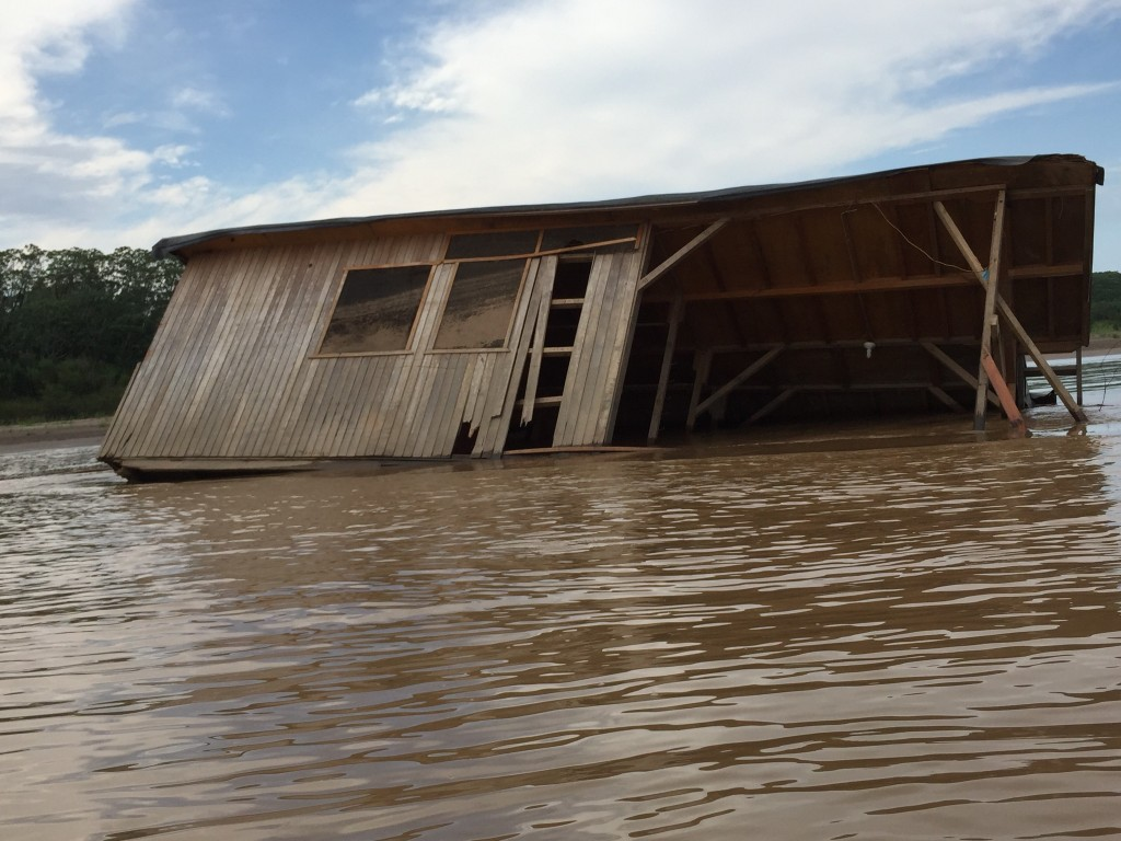 a house uplifted by the most recent storm
