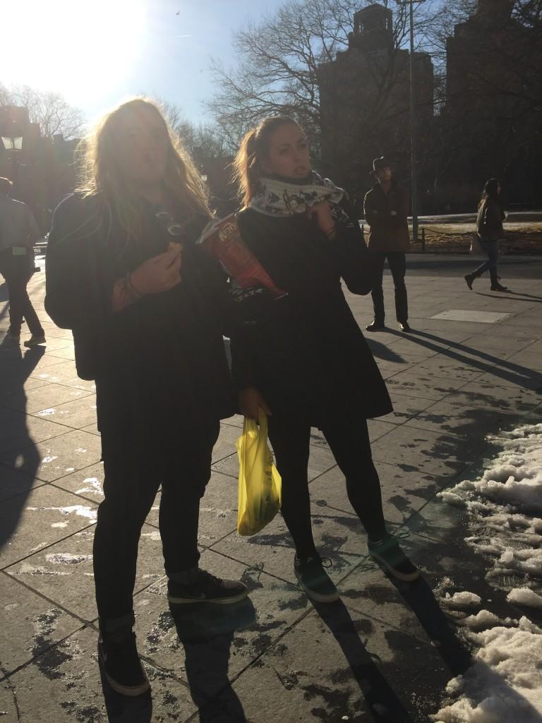 Australian tourists eating Maple Bacon chips at Washington Square Park, New York City