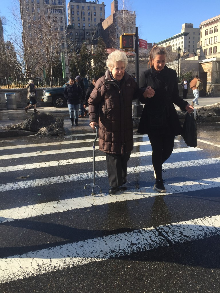 helping old lady cross street at Union Square, New York