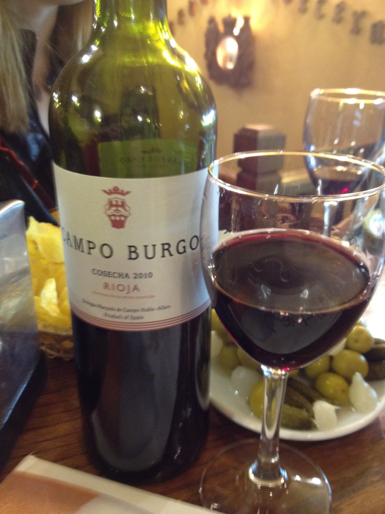 vino tinto with olive and potato chip tapas, Madrid, Spain
