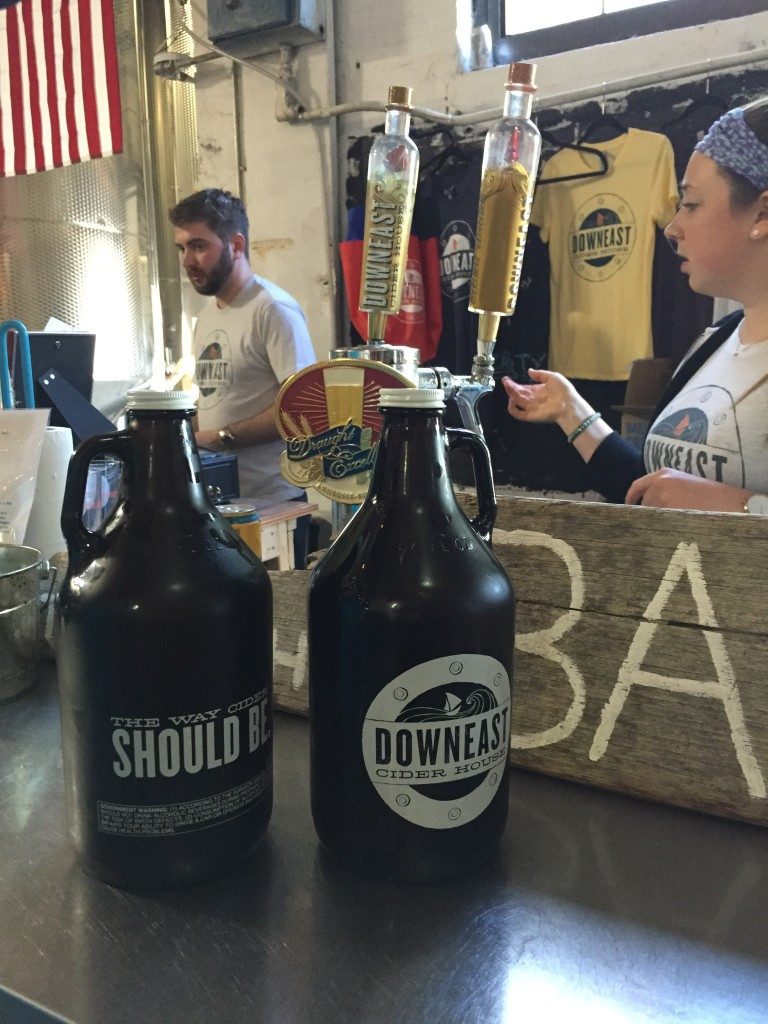 two growlers of Downeast Cider on the bar at Downeast Cidery, Charlestown, MA