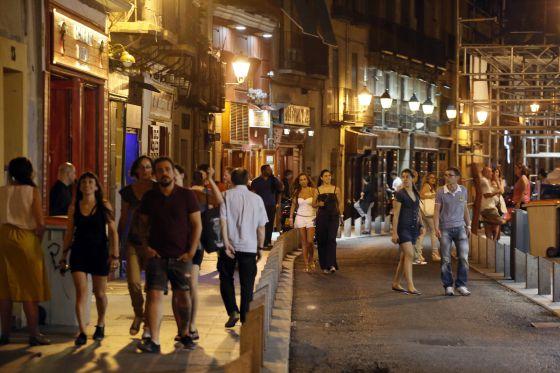 Locals enjoy tapeando, going out for tapas, along La Cava Baja, Madrid