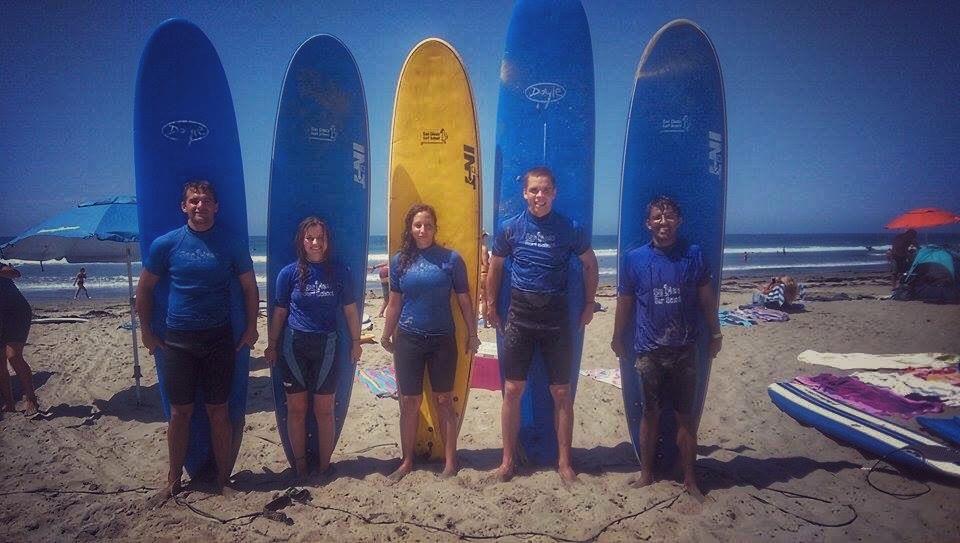 old school surf pose on Pacific Beach, San Diego, California