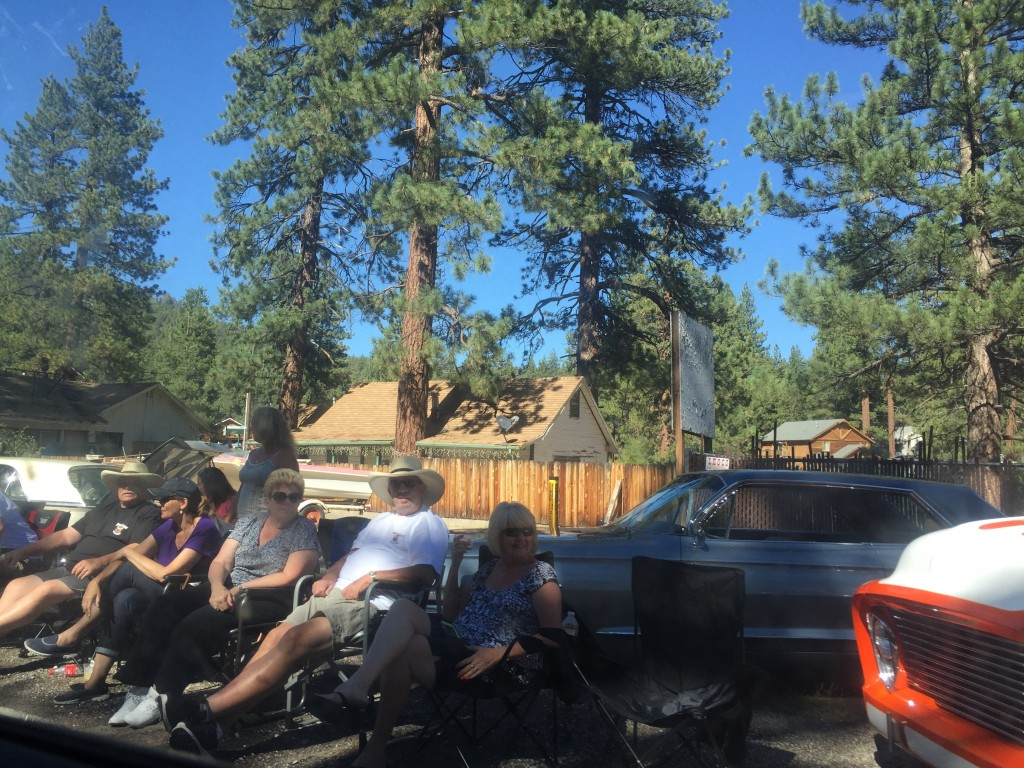 Locals watching the old cars drive by from the Lake Antique Car Club Fun Run, Big Bear Lake, California 2015