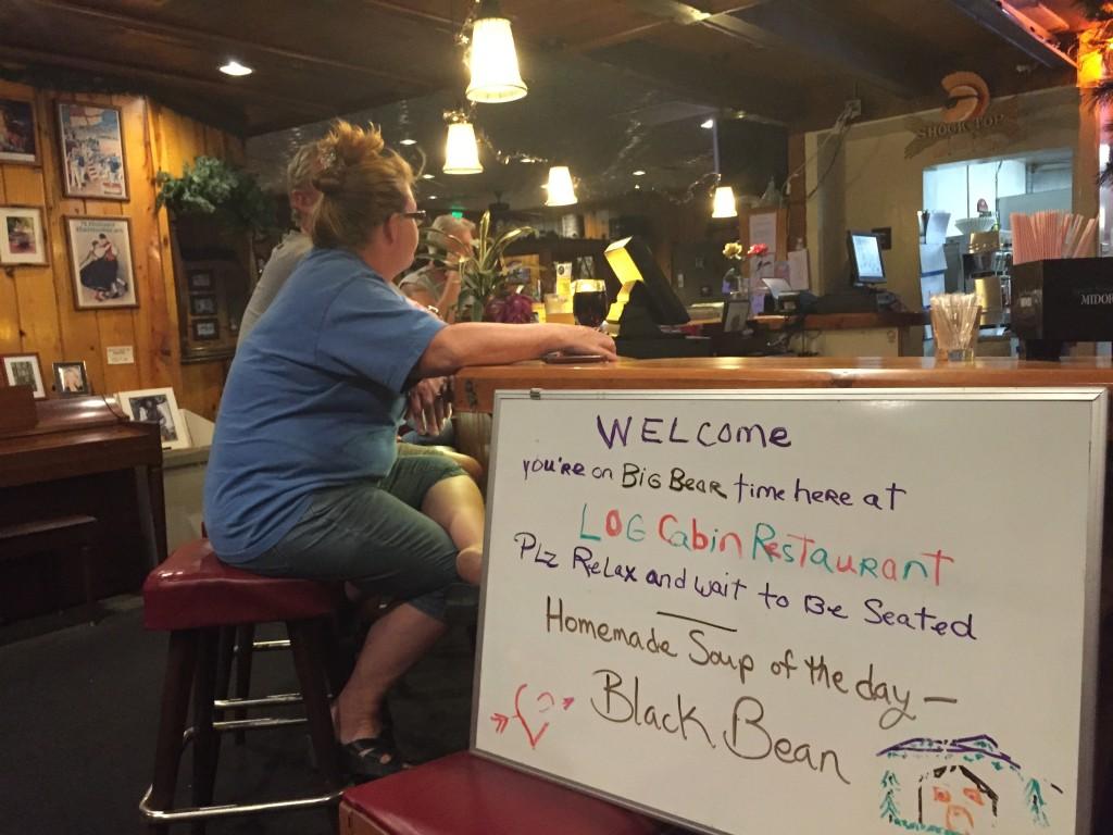 Greeting sign at Log Cabin Restaurant, Big Bear Lake, California