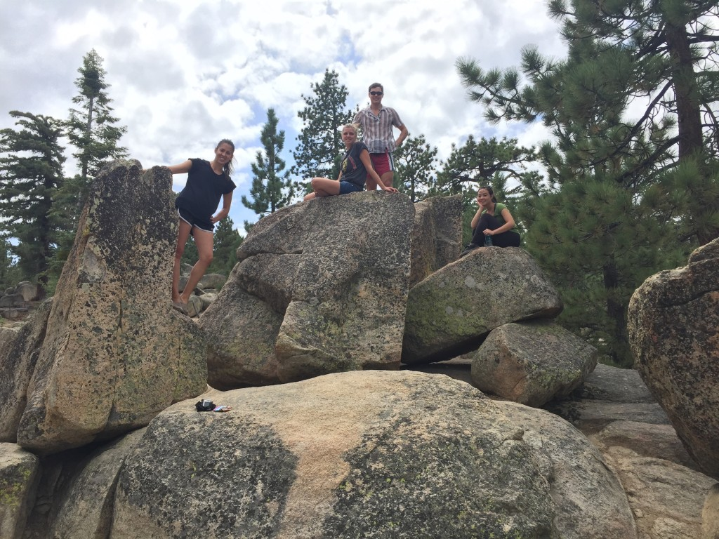 hikers pose on some boulders at Castle Rock, Big Bear Lake, California