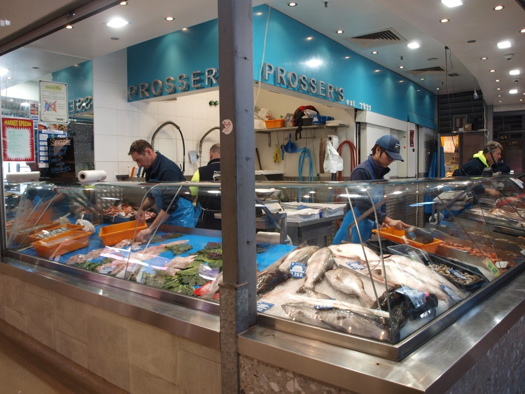 Vendors and seafood at seafood section of Queen Victoria Markets in Melbourne, VIC