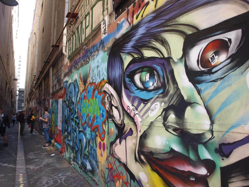 Grafitti showing face in Union Lane in Melbourne