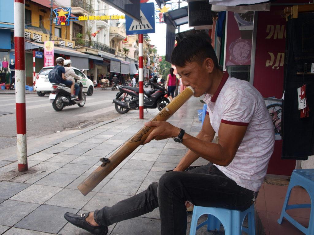 Man smoking large pipe, Hanoi, Vietnam