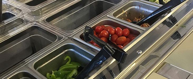 Photo of tomatoes at a salad bar
