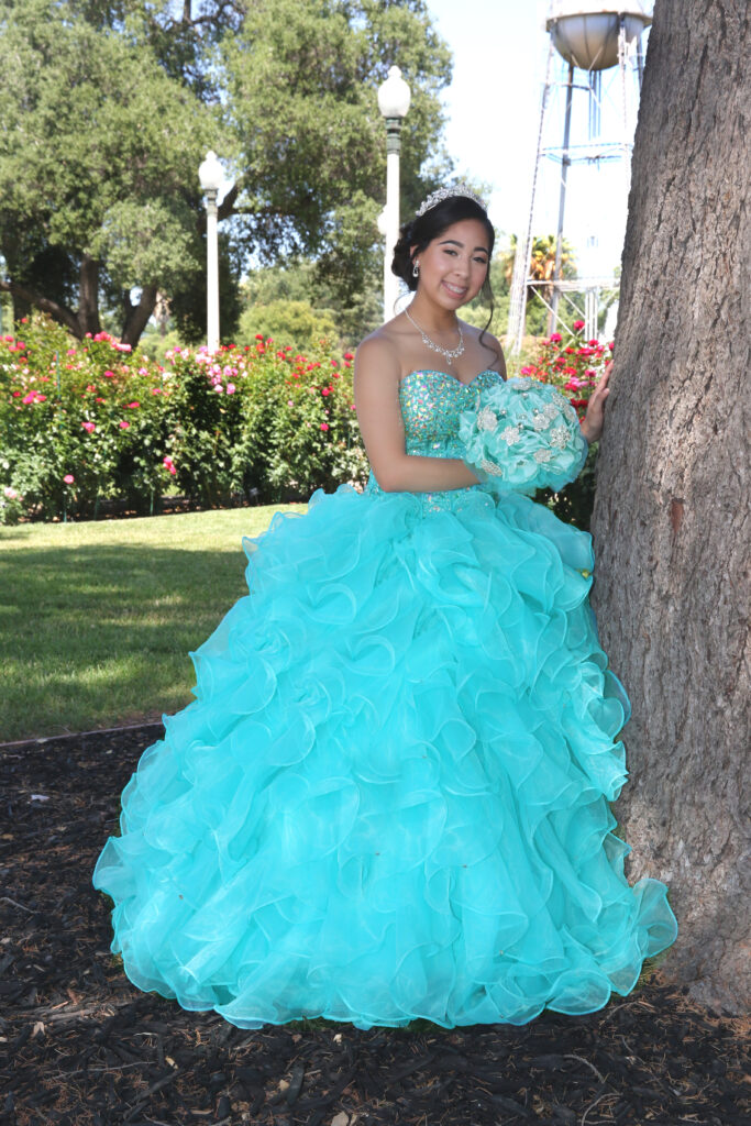 Quinceanera Near a Tree