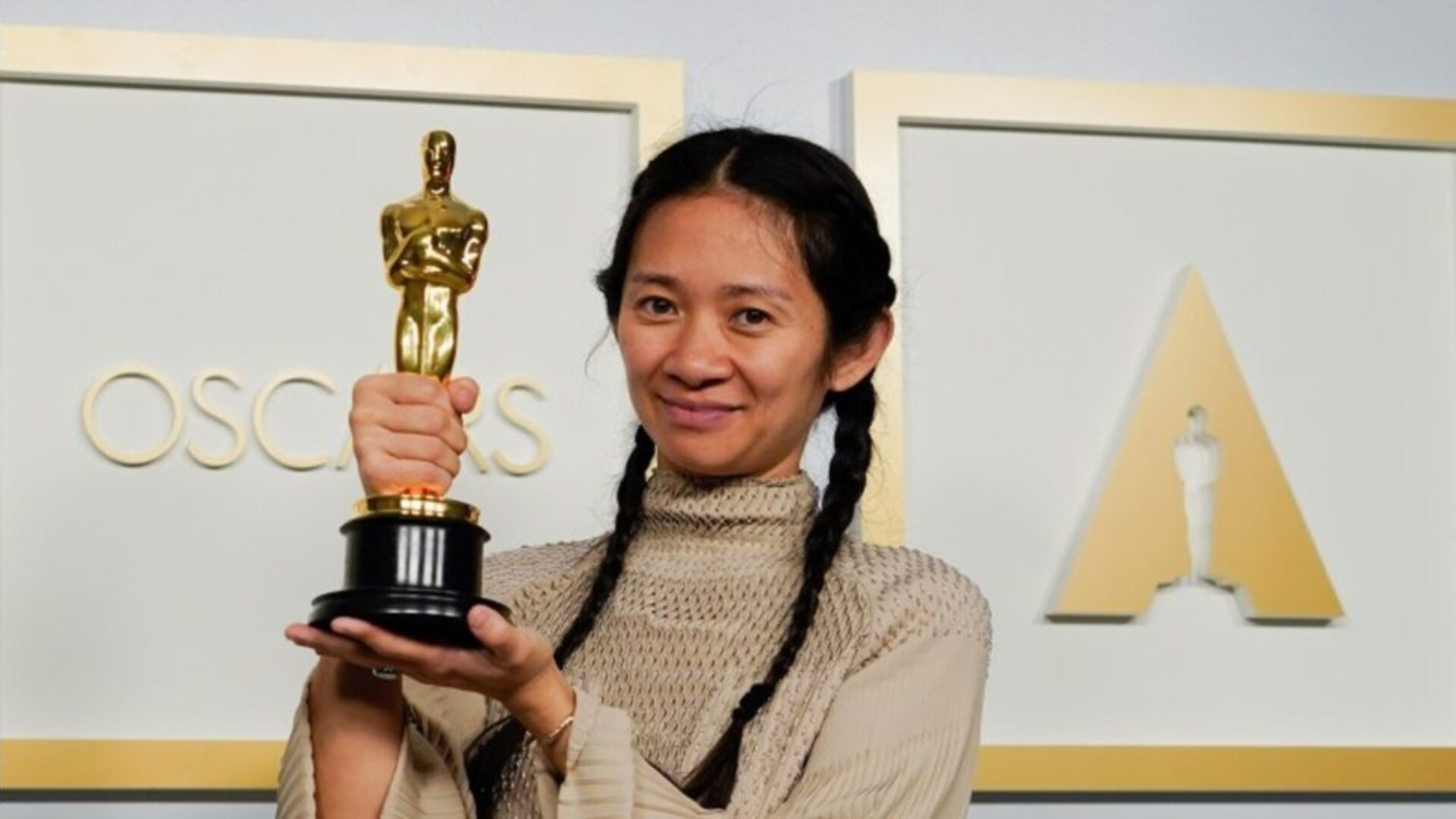 Asian actress holding Oscar
