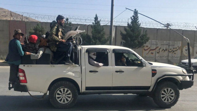 Taliban fighters in pickup