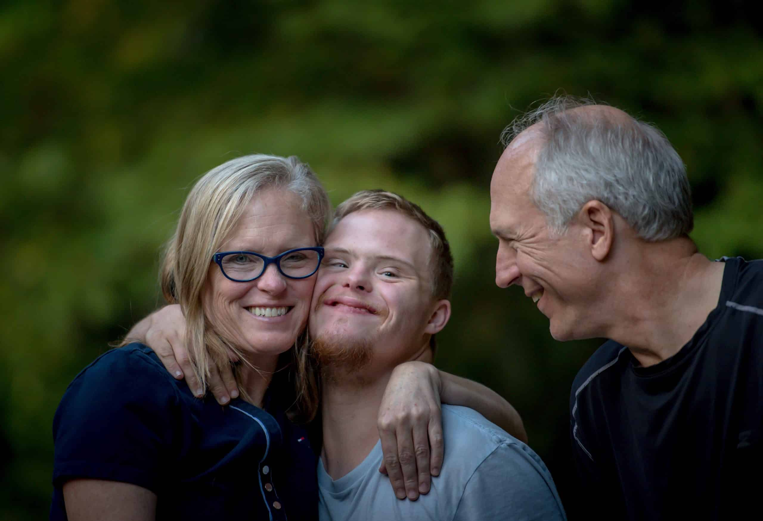 Image of a family smiling because they have established a Special Needs Trust with Siegel Law Group