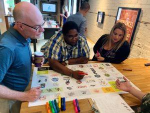 Board chair Jamaal Stricklin reviews design ideas from branding firm Zebradog