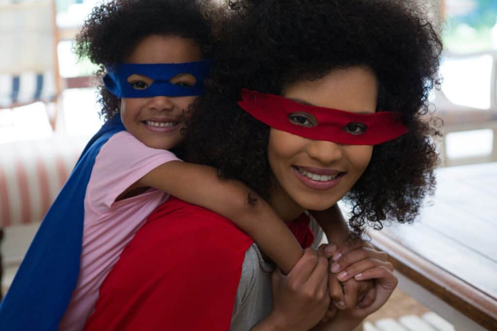 ADHD Mama Superpowers. Mom with daughter wearing capes and masks
