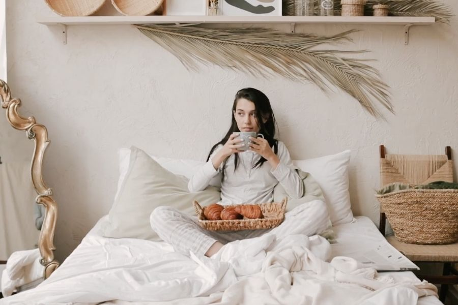Woman drinking tea to support her immune system