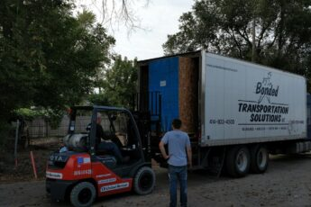 Fifth Ward unloading equipment from truck