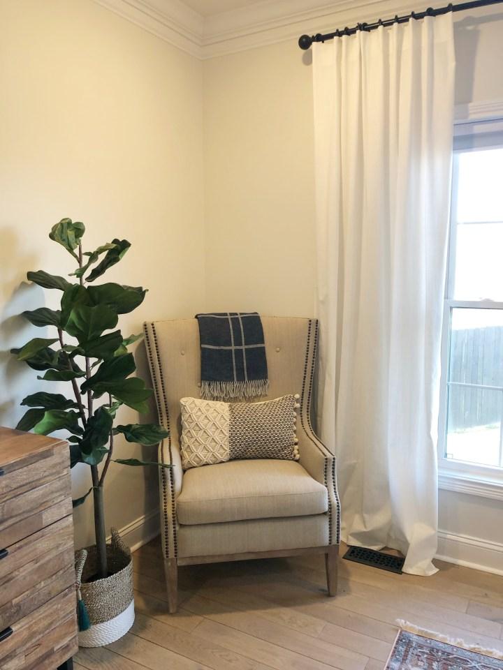 chair in corner of master bedroom