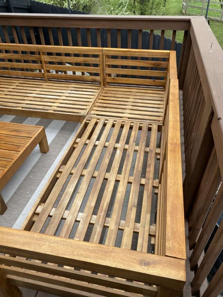 Repaired patio furniture on deck with sanding and stain