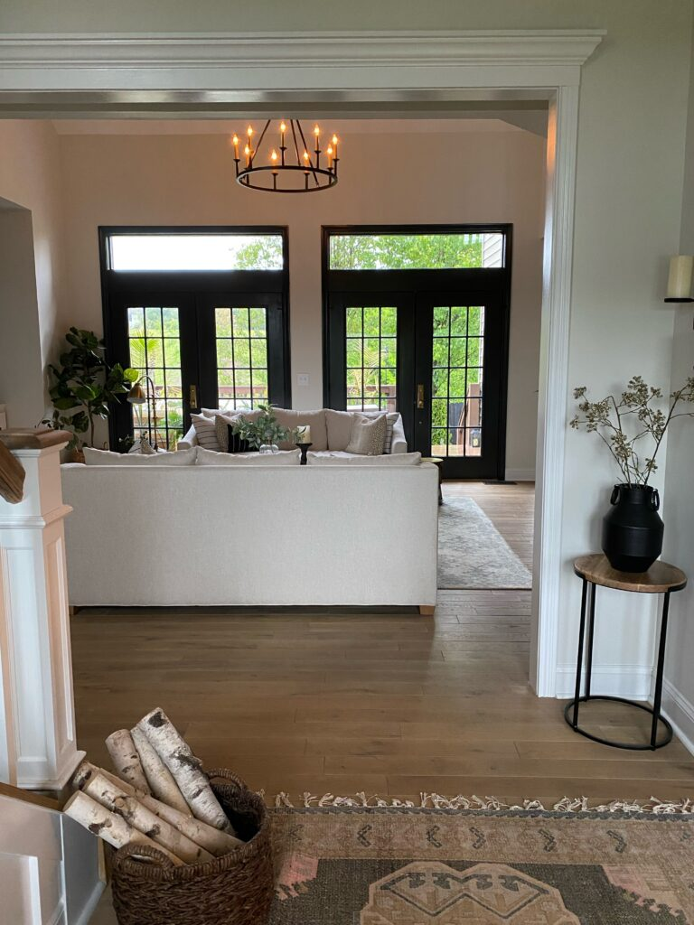 After photo of living room french doors once trim was painted black. The power of paint!