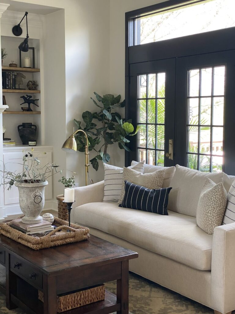 Living room with black french doors