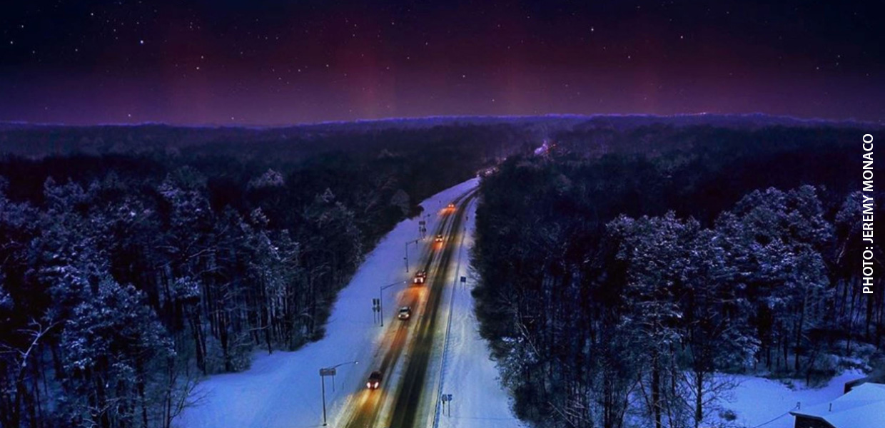 aerial photo of cars driving on snow-covered road