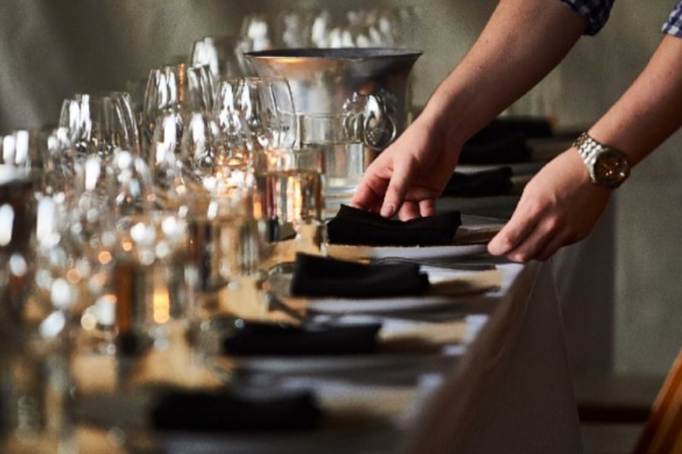 photo of waiter setting a table