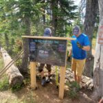 Installing the trail map for our new trail high on Uleda Ridge