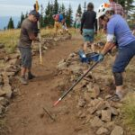 Volunteers putting finishing touches on the final stretch of trail to POP Point