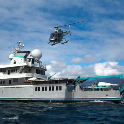 Helicopter taking off from ship in water
