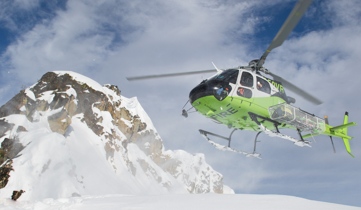 Precision AS350B3 ski helicopter lands in the snow-covered North Cascade mountains