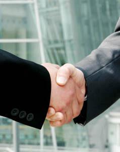 Tax client and CPA handshake - Robert & Associates