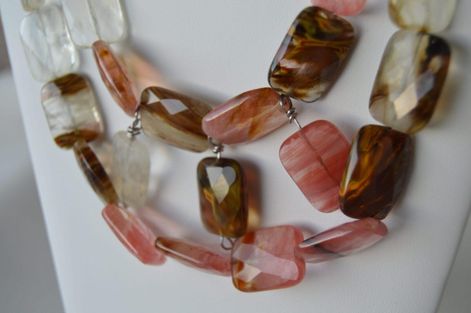 A cherry quartz statement necklace on white