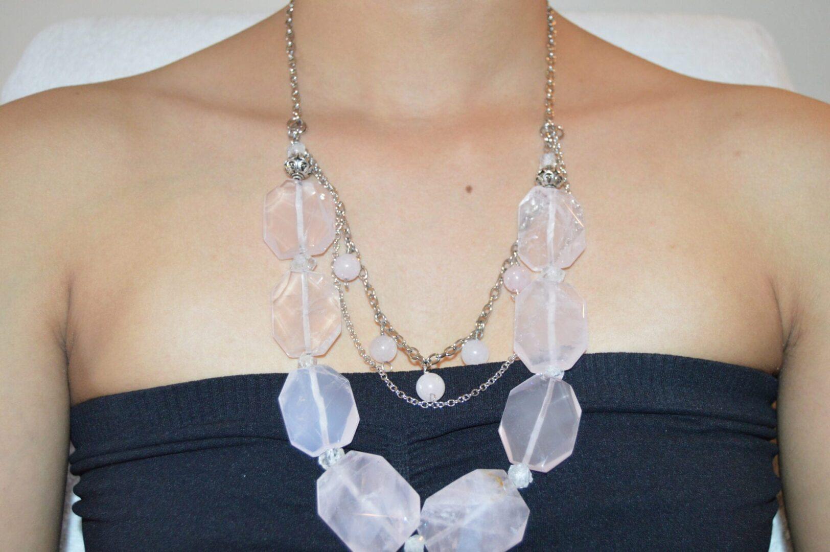 A Love Rush Necklace being worn around the neck