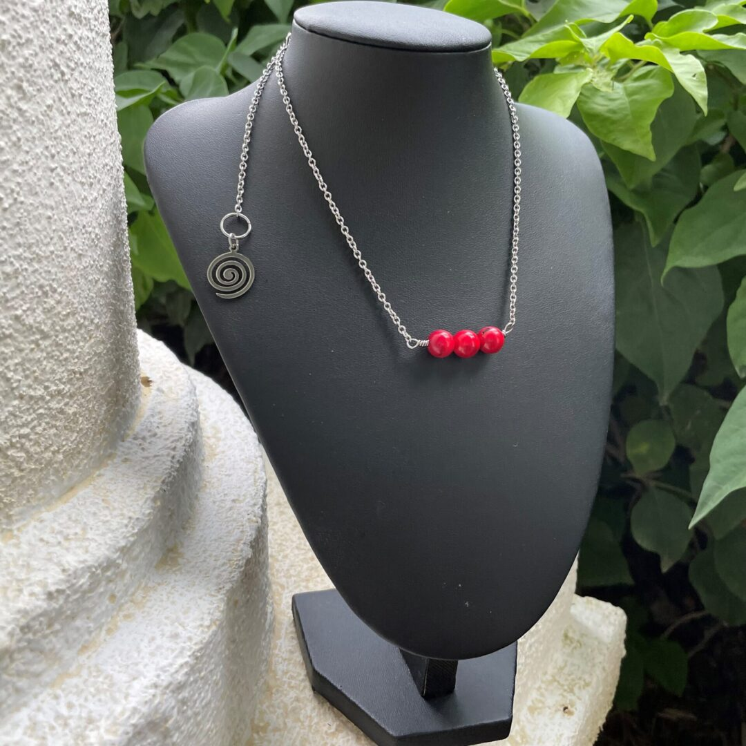 A Coral Three-beaded Necklace