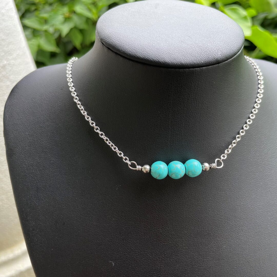 A Howlite Triple Stoned Whisper Necklace on a bust